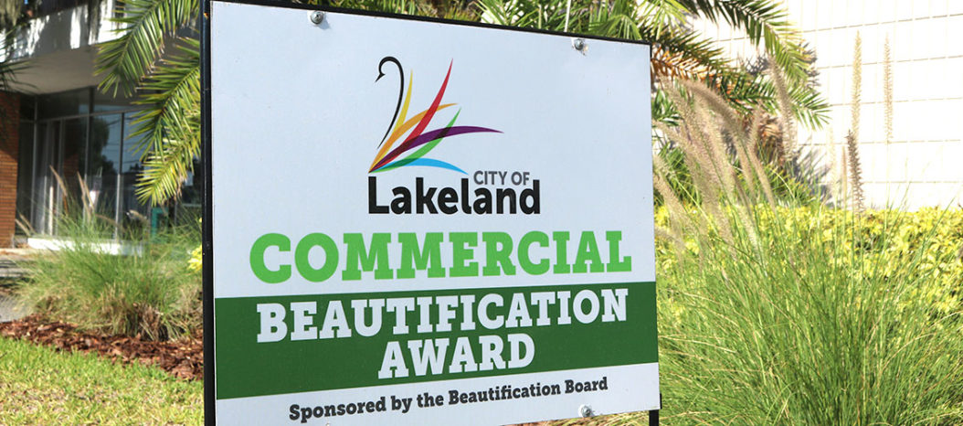 Photo of City of Lakeland Commercial Beautification Award outside GWCF's Lakeland office