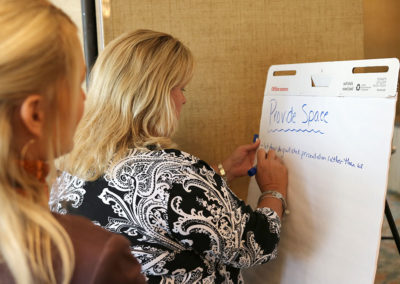 Attendee, Susan, participating in an interactive session