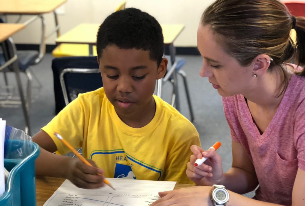 Tutor helping a student with homework