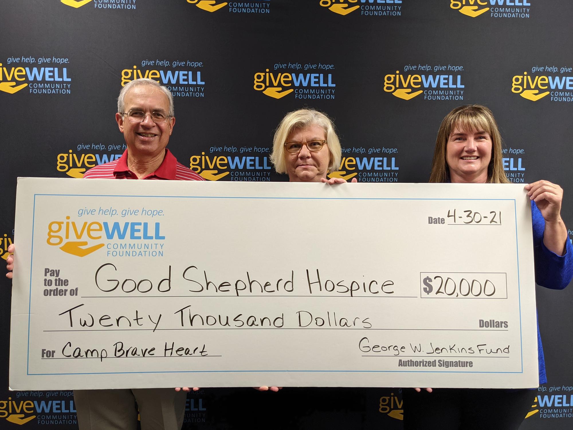 Impact Polk check presentation with Good Shepard Hospice