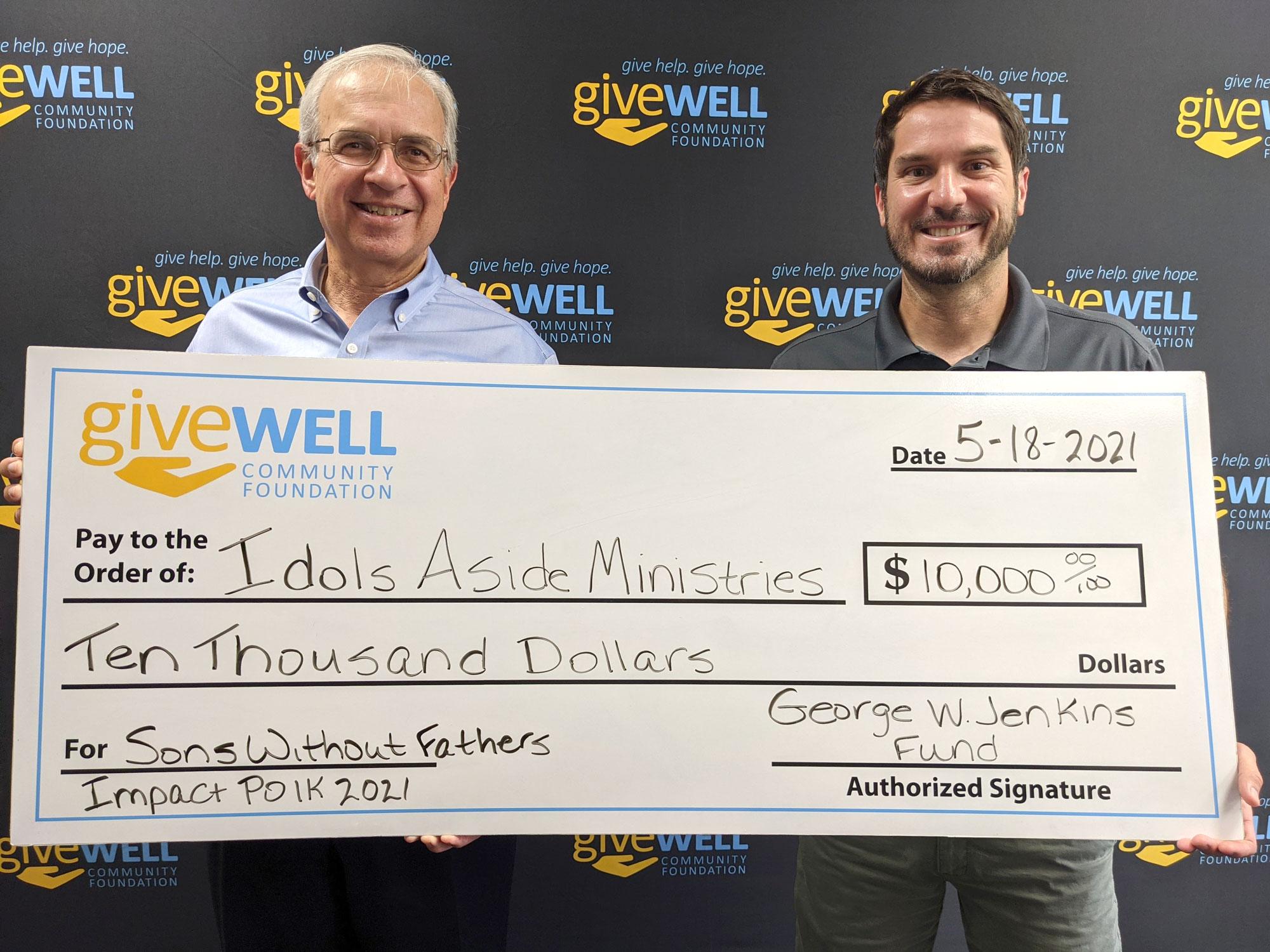 Impact Polk check presentation with Idols Aside Ministries